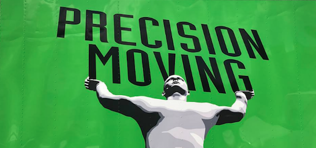 A green moving truck belonging to Precision Moving Company in Boston, Massachusetts.
