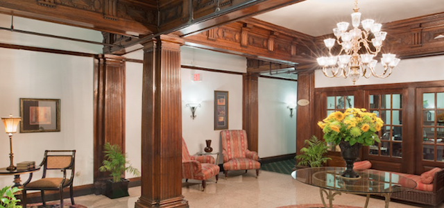 AN interior view of The Parkside Apartment's lobby with wooden features.