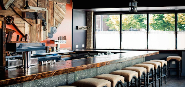 An interior view of The Bronwyn Restaurant's wooden bar top in MA.