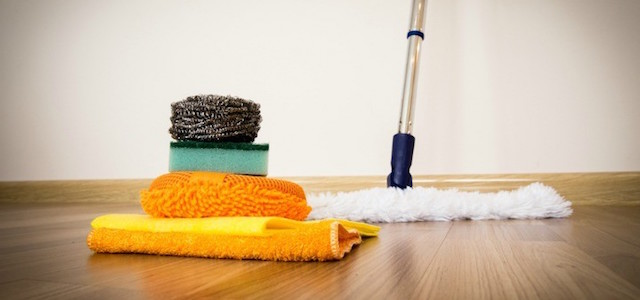 A mop, towels, and cleaning supplies to polish and clean wooden flooring.