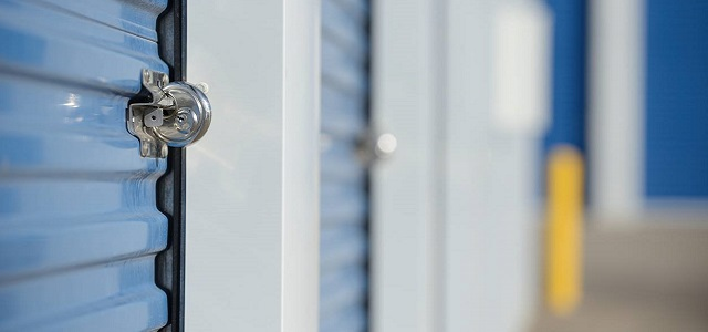 A close up shot of a blue storage locker and silver lock.