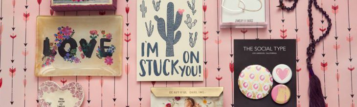 Valentine's Day-themed pictures on a wall with pink wallpaper
