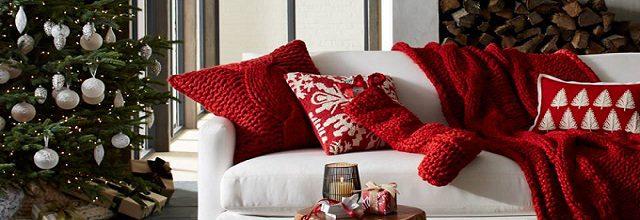 Living room with red Christmas decor and a Christmas tree