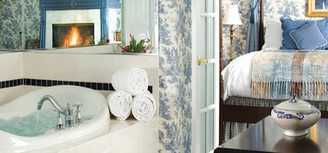 A luxurious blue pastel-colored suite and master bathroom at The Manor on Gold Pond.