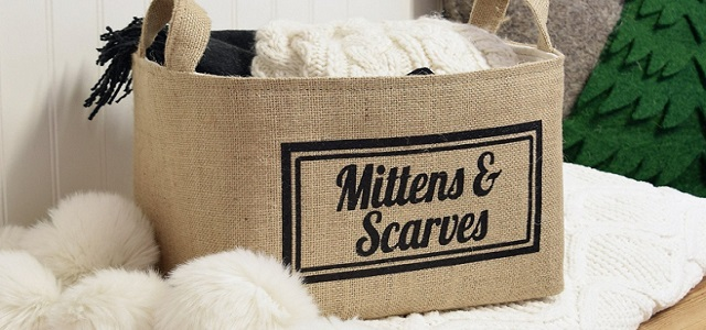 A woven brown basket with mittens and scarves labeled in black font.