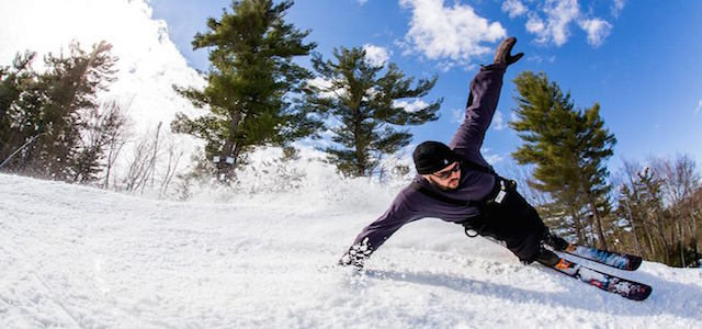 A skier at Nashoba Valley Ski Area sliding down a snow covered mountain.