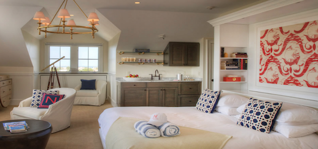 An interior view of a luxury nautical-themed suite at The Nantucket Hotel