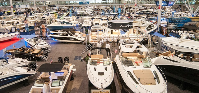 An indoor display of luxury and sport boats at the New England Boat Show.