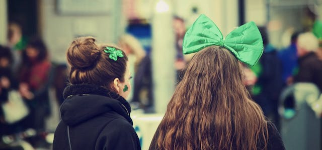 Two girls at a Saint Patrick's Day Parade with Green hair bows.