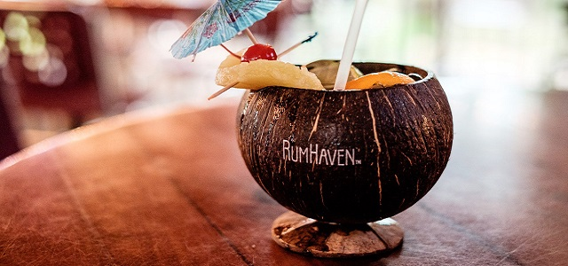 A tropical cocktail drink in a coconut.
