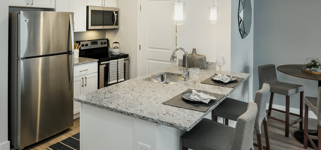 An interior view of a luxury apartment at Landing 53 in Braintree, MA.