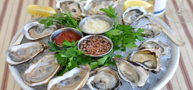 A platter of fresh oysters.