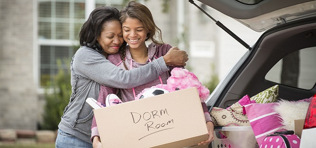 A mother and daughter hugging at a college move-in day.