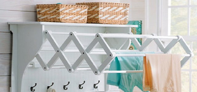 A white clothes drying wall rack.