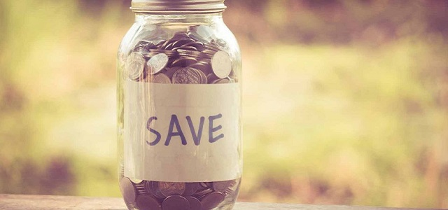 A glass Mason jar filled with spare change for savings.