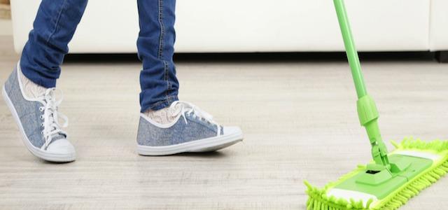 man mopping floor