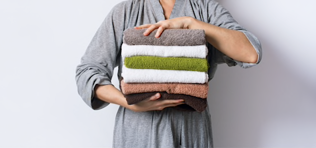 woman-holding-folded-towels