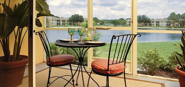 audubon cove patio with pond and outdoor table set