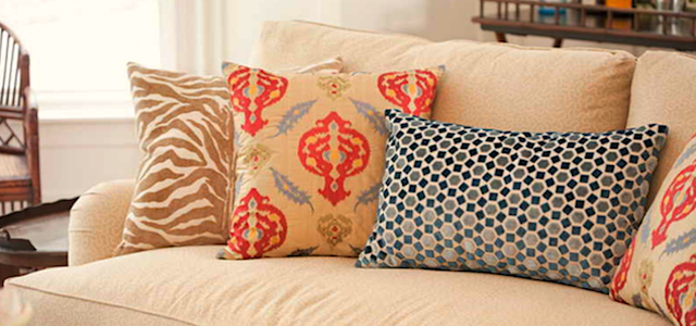 orange and blue throw pillows on the couch