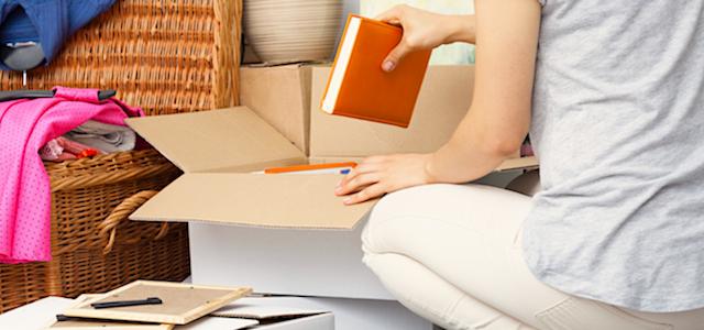 woman putting books into a box