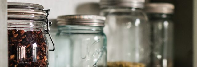spices lined up in mason jars on shelf