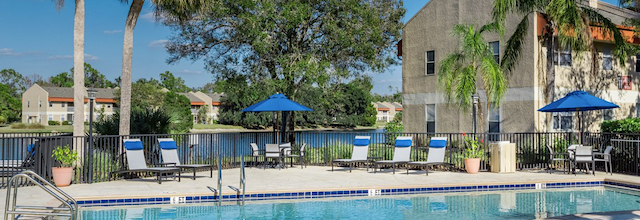 a view of the audubon cove apartment pool.