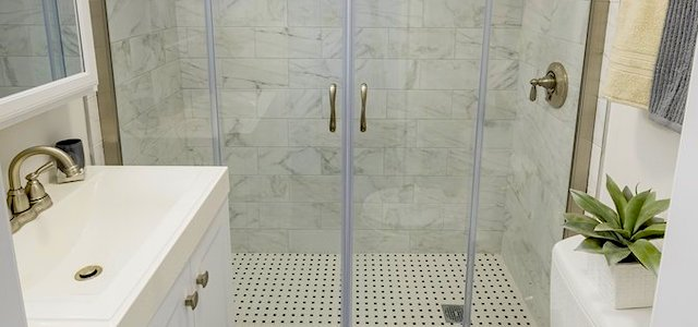 a porcelain sink and shower in a luxury apartment building.