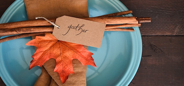 thanksgiving table setting with fall colors and decor.