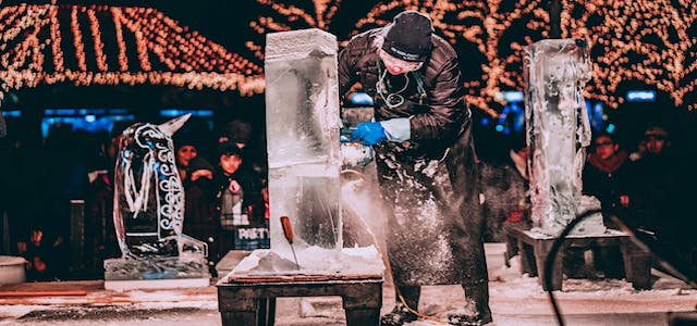 a man sculpting a creation out of ice