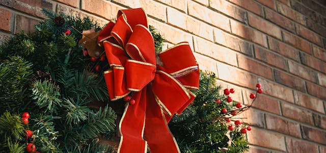 holiday wreath with giant red bow