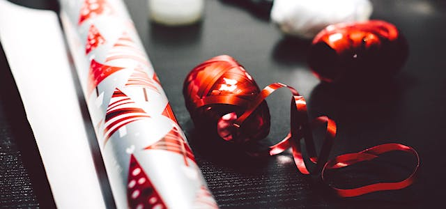 shiny red ribbon and christmas tree wrapping paper