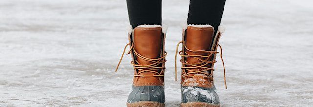 a pair of llbean boots on a snowy driveway