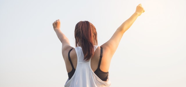 woman celebrating her completed workout