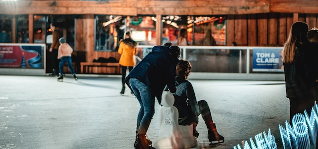 people skating at an outdoor ice rink
